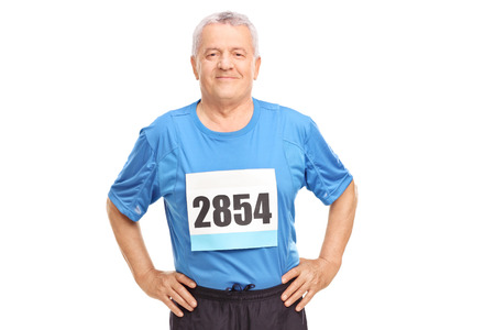 1 mature man: Senior man in sportswear with a race number on his chest looking at the camera isolated on white background