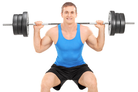 weightlifter: Strong man exercising with a barbell isolated on white background Stock Photo