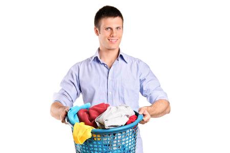 man laundry: Man holding a basket full of laundry isolated on white background