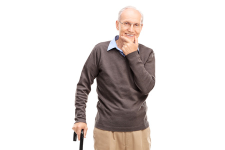 Casual senior with a black wooden cane posing isolated on white background