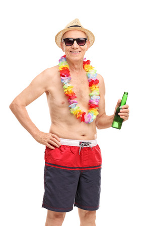 trunk: Vertical shot of a senior man in a swim trunks holding a beer and looking at the camera isolated on white background