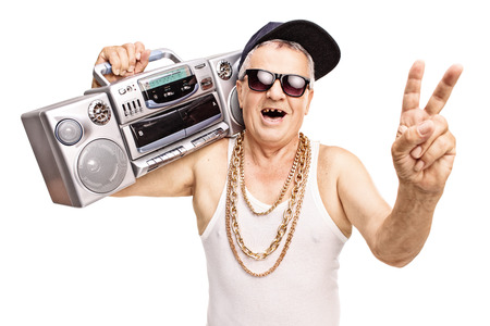 boombox: Toothless senior rapper holding a boombox on his shoulder and gesturing with his hand isolated on white background