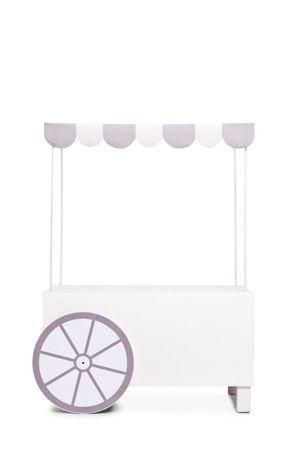 ice cream stand: Vertical studio shot of an empty ice cream stand with a white and gray canopy isolated on white background Stock Photo