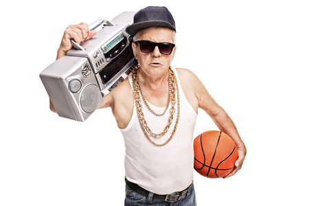 blaster: Senior man in hip hop outfit holding a ghetto blaster and a basketball isolated on white background