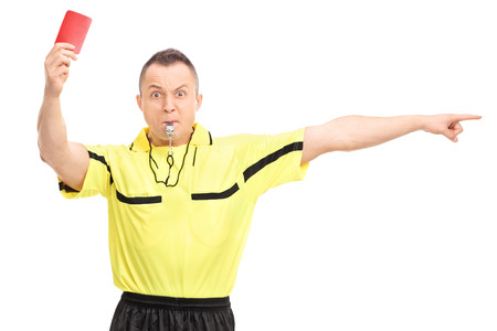 Angry football referee showing a red card and pointing with his hand isolated on white background