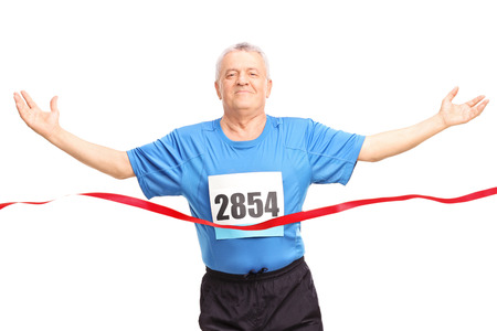 male senior adults: Mature runner finishing a race and celebrating his victory isolated on white background