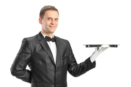 Happy waiter holding a tray isolated on white background photo