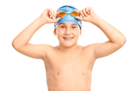 swimming cap: Studio shot of a joyful boy with a blue swim cap and orange swimming goggles isolated on white background Stock Photo