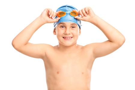 swim goggles: Studio shot of a joyful boy with a blue swim cap and orange swimming goggles isolated on white background Stock Photo