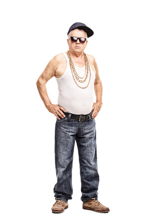 hip hop man: Full length portrait of a senior man in hip-hop clothes looking at the camera isolated on white background