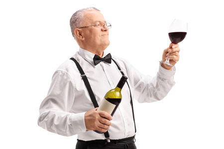 red hand: Elegant mature gentleman holding a bottle and a glass of fine red wine isolated on white background Stock Photo