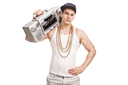 hip hop man: Young male rapper holding a ghetto blaster over his shoulder and looking at the camera isolated on white background