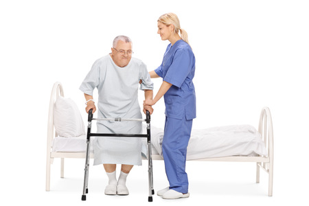 man doctor: Young female nurse helping a senior patient with a walker isolated on white background