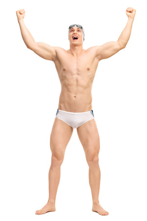 trunk: Full length portrait of an overjoyed male swimmer in white swim trunks celebrating victory isolated on white background