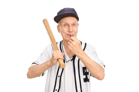 ref: Studio shot of a cheerful senior holding baseball bat and blowing a whistle isolated on white background