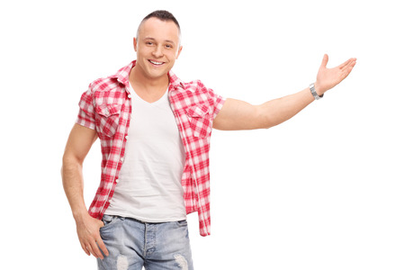 attitudes: Casual young man gesturing with his hand and looking at the camera isolated on white background