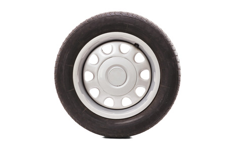 Tires: Studio shot of a car tire isolated on white background