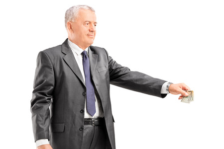 mature businessman: Mature businessman giving money to someone isolated on white background