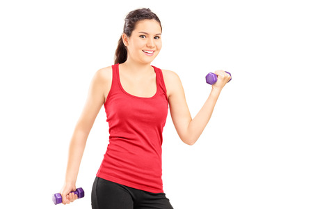 Young girl lifting dumbbells isolated on white background photo