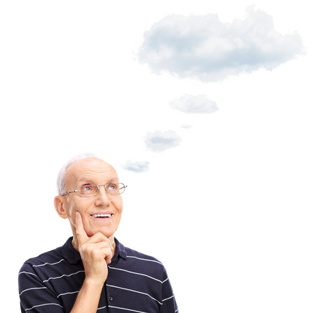 old people: Pensive senior gentleman thinking about something with a cloud floating over his head isolated on white background