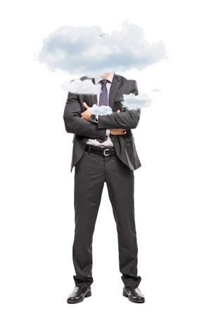 cocky: Full length portrait of a businessman in a gray suit with his head up in the clouds isolated on white background Stock Photo