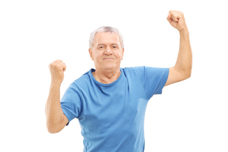 raising: Happy senior standing on a weight scale isolated on white background Stock Photo