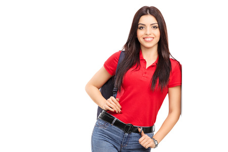leaning: Young woman carrying a backpack and posing isolated on white background