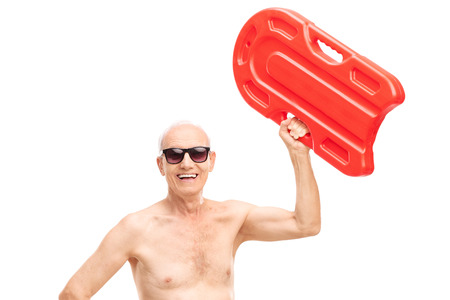 swimming to float: Shirtless senior holding a swimming float up in the air and looking at the camera isolated on white background