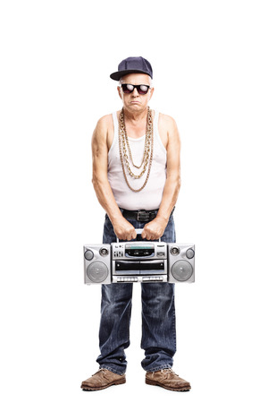 hardcore: Full length portrait of a hardcore rapper holding a ghetto blaster and looking at the camera isolated on white background