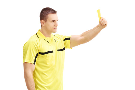 ref: Football referee showing a yellow card isolated on white background