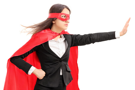 stopping: Female superhero making a stop sign with her hand isolated on white background