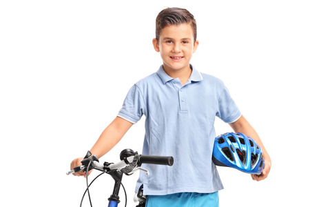 kids hand: Little kid posing with his bicycle and holding a blue helmet in his hand isolated on white background Stock Photo