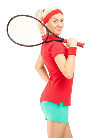 racquet: Vertical shot of a young female tennis player holding a racquet and posing isolated on white background