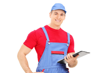 clipboard isolated: Mechanic holding a clipboard isolated on white background