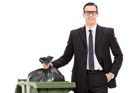 young businessman taking out the trash isolated on white background