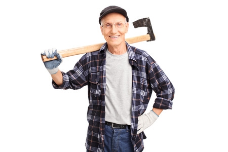 logger: Studio shot of a cheerful senior logger holding an axe and looking at the camera isolated on white background Stock Photo