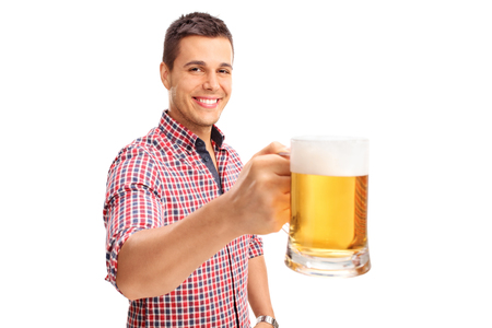 pilsner beer: Joyful man holding a large beer mug full of beer and looking at the camera isolated on white background