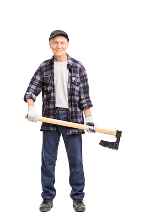 axe: Full length portrait of a senior man in a blue checkered shirt holding an axe and looking at the camera isolated on white background