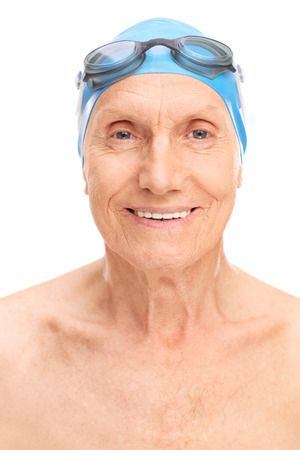 swim cap: Close-up on an old man with a blue swim cap and black swimming goggles isolated on white background