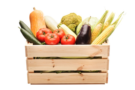 Studio shot of a wooden crate full of fresh vegetables isolated on white background Foto de archivo