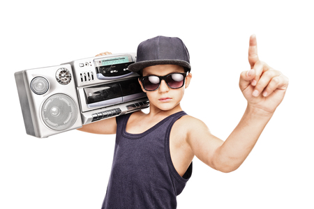 Junior rapper carrying a ghetto blaster and gesturing with his hand isolated on white background