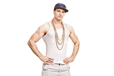 chain: Studio shot of a young male rapper with a blue cap and a golden chain looking at the camera isolated on white background