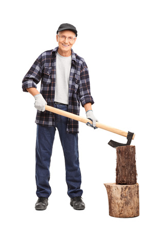 splitting: Full length portrait of a senior man in a checkered shirt splitting a log with an axe isolated on white background