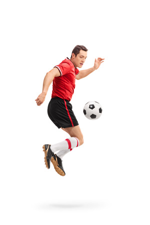 midair: Full length portrait of a young male football player shot in mid-air while performing rainbow flick isolated on white background Stock Photo