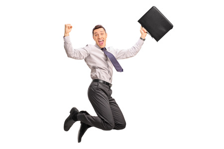 happy businessman: Delighted businessman holding a suitcase and jumping out of joy isolated on white background