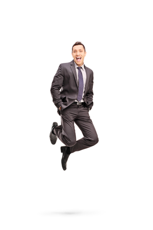 white suit: Full length portrait of a joyful businessman shot in mid-air while jumping out of happiness isolated on white background