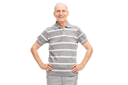 senior men: Casual senior in a polo shirt smiling and looking at the camera isolated on white background Stock Photo