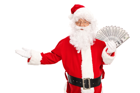 santa: Studio shot of Santa Claus holding a spread of money and gesturing with his hand isolated on white background Stock Photo