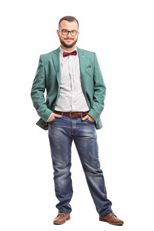 coat: Full length portrait of a young man posing in a green coat and a red bow-tie isolated on white background Stock Photo