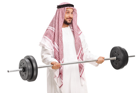a white robe: Young male Arab in a white robe and checkered veil exercising with a barbell isolated on white background
